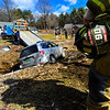 KRISTOPHER RADDER - BRATTLEBORO REFORMER<br /> Crews respond to a vehicle that rolled over into the stream bed located on the property of 4657 Calvin Coolidge Memorial Highway on Thursday, March 9, 2017. The driver of the vehicle was transported to Brattleboro Memorial Hospital for minor injuries. People at the property were able to get the driver out before rescue crews reached the scene.