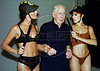 "Ronald Biggs of England poses with models Milene Zardo, left,  and Francine Mello, during a photo session for the Duloren lingerie company, Rio de Janeiro, Brazil, January 25, 2001. The ""Great Train Robber"" departed Brazil May 6, 2001 after living in Rio for 31 years. After suffering three strokes, the frail Biggs departed Rio enroute to England aboard a private jet chartered by ""The Sun"" newspaper of England. (Austral Foto/Renzo Gostoli)"