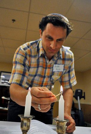 Rabbi Josh Rose lights candles during a Rosh Hashanah service at the Boulder Meridian in Boulder, Colorado Thursday September 13, 2012. DAILY CAMERA/ JESSICA CUNEO