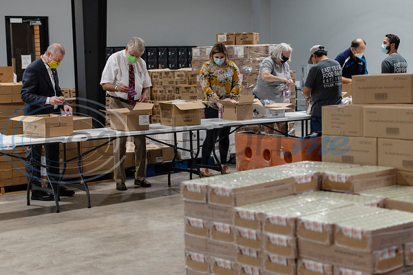 Members of various Rotary clubs from across East Texas volunteer their time to pack after school snack bags at the East Texas Food Bank on Wednesday, Aug. 12, 2020.