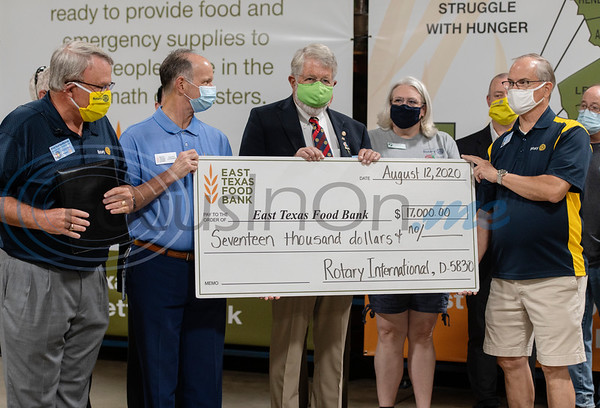 Rotary International District 5830, which encompasses Rotary clubs in Northeast Texas and Southeast Oklahoma presented a $17,000 grant to the East Texas Food Bank. Pictured from left: Ted Huffhines of Marshall Rotary Club, East Texas Food Bank CEO Dennis Cullinane, Jim Finstrom of Rotary Club of Jefferson and Lee Montgomery of Rotary of South Tyler.