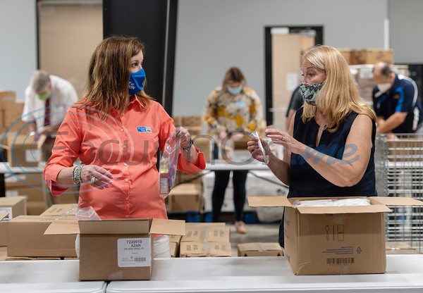 Donna Sharp president, Rotary Club of Longview-Greggton, and Holly Lewis of the Rotary Club of Tyler, volunteer packing after school snack bags at the East Texas Food Bank on Wednesday, Aug. 12, 2020. Rotary International District 5830, which encompasses Rotary clubs in Northeast Texas and Southeast Oklahoma presented a $17,000 grant to the East Texas Food Bank.