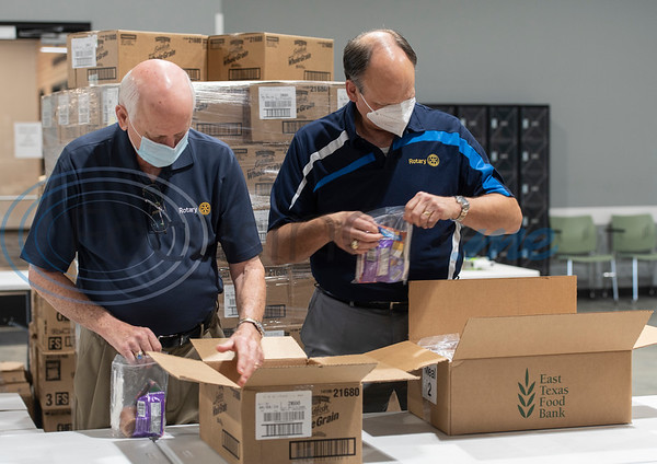 David L. Jones of Tyler Rotary Club and Carroll Greenwaldt of Rotary Club of Longview pack after school snack bags at the East Texas Food Bank on Wednesday, Aug. 12, 2020. Rotary International District 5830, which encompasses Rotary clubs in Northeast Texas and Southeast Oklahoma presented a $17,000 grant to the East Texas Food Bank.
