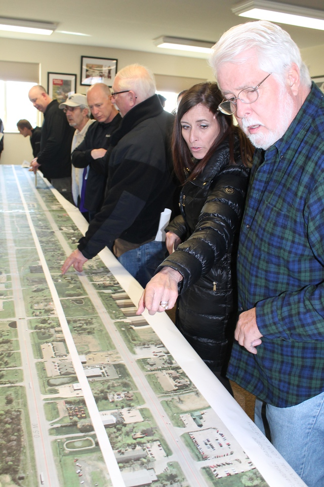 LAWRENCE PANTAGES / GAZETTE Laura Zangmeister and Steve Brown came to a public meeting held by the Ohio Department of Transportation on Tuesday to display proposed guardrail installations on state Route 18 between Medina Line Road to the east and Windfall Road to the west. Zangmeister owns property at 1180 Medina Road where the Raymond James offices are housed. Brown has used Route 18 for 10 years for a warehouse operation there.