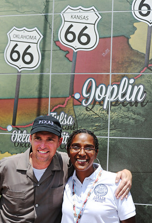 """Globe/T. Rob Brown<br /> Mayor Melodee Colbert-Kean, right, and Jay Ward of Kansas City, creative director with Pixar's """"Cars"""" franchise, pose for photos under the new Joplin Route 66 tile murals following the opening celebration Friday afternoon, Aug. 2, 2013, for the Route 66 International Festival. The mural is located on Main Street, near the intersection with 7th Street."""
