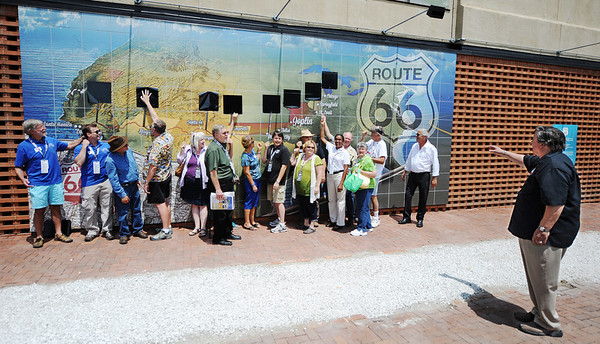 Globe/T. Rob Brown<br /> Michael Wallis, right, co-founder of the Route 66 Alliance, gives the signal to unveil each state's Route 66 signs on a tile mural during the opening celebration Friday afternoon, Aug. 2, 2013, for the Route 66 International Festival.