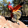 "Running River School kindergartner Joseph Faisal climbs on a rock during a school hike on Friday, Jan. 13, at the Shanahan Ridge Trail in Boulder. For a video of the hike go to  <a href=""http://www.dailycamera.com"">http://www.dailycamera.com</a><br />  Jeremy Papasso/ Camera"
