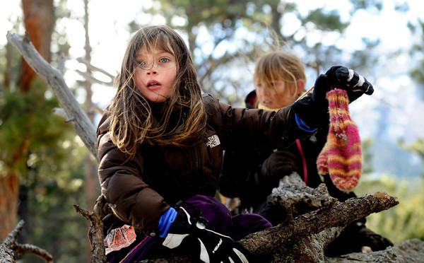 "Running River School second-graders Kate Flaherty, left, and Charlotte Jett-Moore play on top of a log during a school hike on Friday, Jan. 13, at the Shanahan Ridge Trail in Boulder. For a video of the hike go to  <a href=""http://www.dailycamera.com"">http://www.dailycamera.com</a><br />  Jeremy Papasso/ Camera"