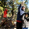 """Running River School Director Nancy Monson points to a ridge while second grader Zorba Abraxus looks through his binoculars during a school hike on Friday, Jan. 13, at the Shanahan Ridge Trail in Boulder. Third grade student Owen Hinrichs, left, was watching from a distance. For a video of the hike go to  <a href=""""http://www.dailycamera.com"""">http://www.dailycamera.com</a><br />  Jeremy Papasso/ Camera"""
