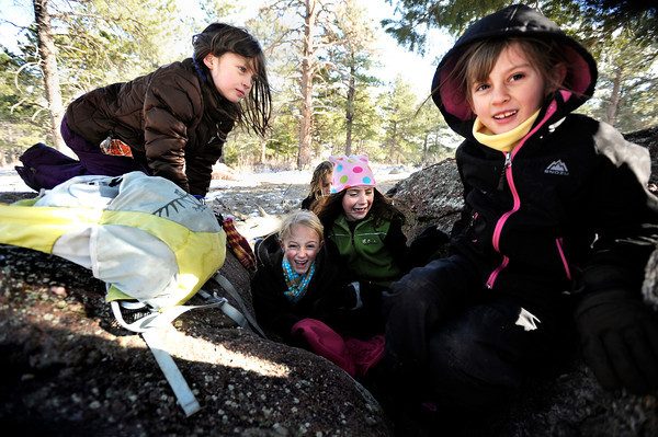 """Running River School second-graders Kate Flaherty, left, Maisie Groutt, Ella Williams, Charlotte Jett-Moore, right, and Jadakai Lijoi, back, play together under a tree during a school hike on Friday, Jan. 13, at the Shanahan Ridge Trail in Boulder. For a video of the hike go to  <a href=""""http://www.dailycamera.com"""">http://www.dailycamera.com</a><br />  Jeremy Papasso/ Camera"""