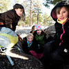 "Running River School second-graders Kate Flaherty, left, Maisie Groutt, Ella Williams, Charlotte Jett-Moore, right, and Jadakai Lijoi, back, play together under a tree during a school hike on Friday, Jan. 13, at the Shanahan Ridge Trail in Boulder. For a video of the hike go to  <a href=""http://www.dailycamera.com"">http://www.dailycamera.com</a><br />  Jeremy Papasso/ Camera"