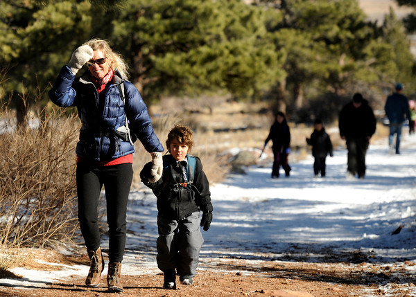 """Running River School Director Nancy Monson walks with kindergartner Harper Arenson-Pie during a school hike on Friday, Jan. 13, at the Shanahan Ridge Trail in Boulder. For a video of the hike go to  <a href=""""http://www.dailycamera.com"""">http://www.dailycamera.com</a><br />  Jeremy Papasso/ Camera"""