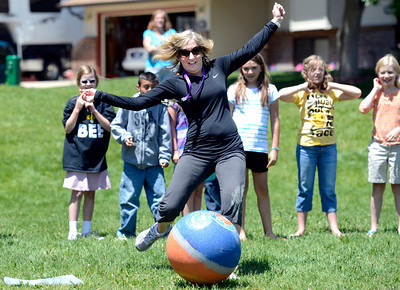 Fifth grade teacher Holly Saltz kicks the ball as hard as she can during a kickball game on Thursday, May 24, at Ryan Elementary School in Lafayette. For more photos and video of the 5th grade vs. the teachers kickball game go to www.dailycamera.com Jeremy Papasso/ Boulder Daily Camera