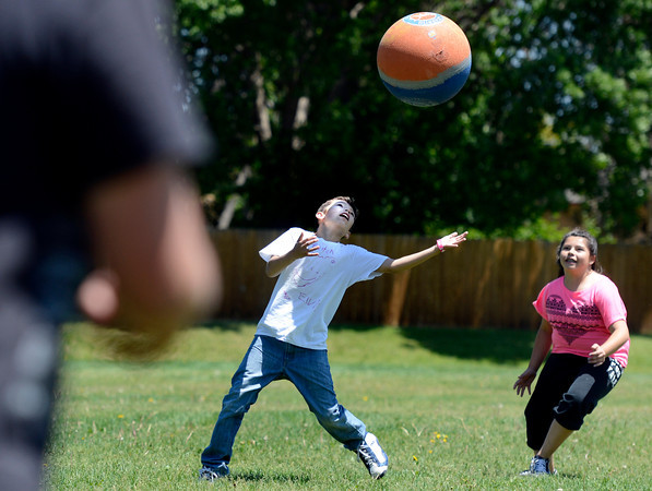 "Fifth grader Ryan Herrera tries to catch a pop fly in front of classmate Tomi Kay Borrego during a kickball game on Thursday, May 24, at Ryan Elementary School in Lafayette. For more photos and video of the 5th grade vs. the teachers kickball game go to  <a href=""http://www.dailycamera.com"">http://www.dailycamera.com</a><br /> Jeremy Papasso/ Boulder Daily Camera"