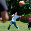 """Fifth grader Ryan Herrera tries to catch a pop fly in front of classmate Tomi Kay Borrego during a kickball game on Thursday, May 24, at Ryan Elementary School in Lafayette. For more photos and video of the 5th grade vs. the teachers kickball game go to  <a href=""""http://www.dailycamera.com"""">http://www.dailycamera.com</a><br /> Jeremy Papasso/ Boulder Daily Camera"""