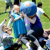 """Fourth grade teacher Molly Hayes falls on top of first grader Tyler Price after making a catch during a kickball game on Thursday, May 24, at Ryan Elementary School in Lafayette. For more photos and video of the 5th grade vs. the teachers kickball game go to  <a href=""""http://www.dailycamera.com"""">http://www.dailycamera.com</a><br /> Jeremy Papasso/ Boulder Daily Camera"""