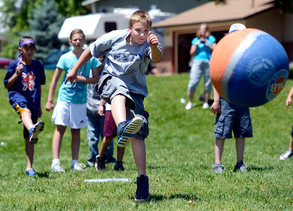 "Fifth grader Brayden Rizzi kicks the ball during a kickball game on Thursday, May 24, at Ryan Elementary School in Lafayette. For more photos and video of the 5th grade vs. the teachers kickball game go to  <a href=""http://www.dailycamera.com"">http://www.dailycamera.com</a><br /> Jeremy Papasso/ Boulder Daily Camera"