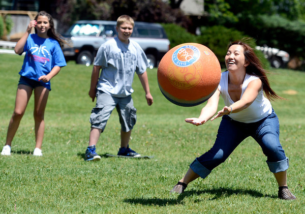 "English second language teacher Kha Xiong tries to make a catch during a kickball game on Thursday, May 24, at Ryan Elementary School in Lafayette. For more photos and video of the 5th grade vs. the teachers kickball game go to  <a href=""http://www.dailycamera.com"">http://www.dailycamera.com</a><br /> Jeremy Papasso/ Boulder Daily Camera"
