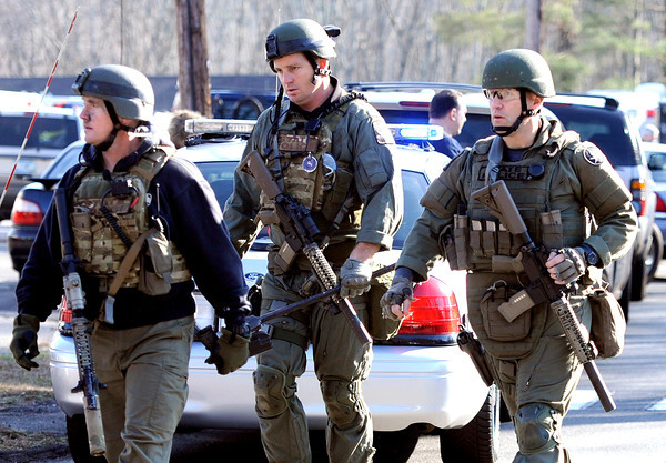 State Police are on scene following a shooting at the Sandy Hook Elementary School in Newtown, Conn. where authorities say a gunman opened fire, leaving 27 people dead, including 20 children, Friday, Dec. 14, 2012. (AP Photo/Jessica Hill)