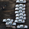 Police vehicles are lined up near a triage near Sandy Hook Elementary School in Newtown, Conn., where authorities say a gunman opened fire inside an elementary school in a shooting that left 27 people dead, including 20 children, Friday, Dec. 14, 2012. (AP Photo/Julio Cortez)