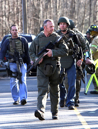 Heavily armed Connecticut State troopers are on the scene at Sandy Hook Elementary School in Newtown, Conn. where authorities say a gunman opened fire, leaving 27 people dead, including 20 children, Friday, Dec. 14, 2012.(AP Photo/The Journal News, Frank Becerra Jr.) MANDATORY CREDIT, NYC OUT, NO SALES, TV OUT, NEWSDAY OUT; MAGS OUT