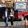 Parents walk away from the Sandy Hook Elementary School with their children following a shooting at the school, Friday, Dec. 14, 2012 in Newtown, Conn. A man opened fire inside the Connecticut elementary school where his mother worked Friday, killing 26 people, including 20 children, and forcing students to cower in classrooms and then flee with the help of teachers and police. (AP Photo/The Journal News, Frank Becerra Jr.) MANDATORY CREDIT, NYC OUT, NO SALES, TV OUT, NEWSDAY OUT; MAGS OUT