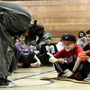 "Jack Jones, at left and Anders Eyberg look on as Scott K. Leslie plays the monster Caliban at Douglass Elementary as part of the Colorado Shakespeare Festival's school anti-bullying tour based on ""The Tempest"" that focuses on themes of anti-violence and forgiveness on Thursday February 28, 2013. For more photos go to  <a href=""http://www.dailycamera.com"">http://www.dailycamera.com</a><br /> Photo by Paul Aiken"