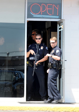 Armed officers at the entrance of a business  where a reported shooting happened Monday morning at Boulder Stove and Floor in Boulder.<br /> Photo by Marty Caivano / The Boulder Camera