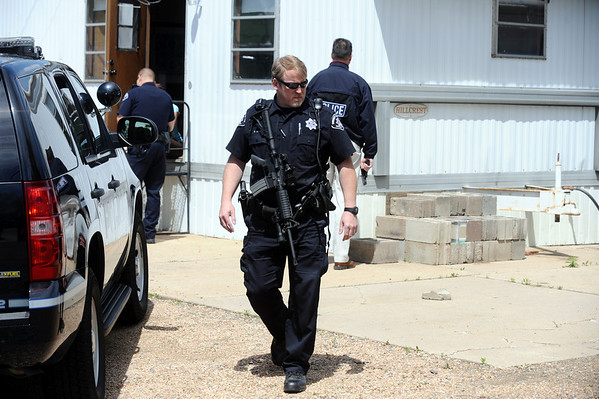 Boulder Police investigate  the scene of a reported multiple fatal shooting Monday morning at Boulder Stove and Floor.<br /> Photo by Marty Caivano / The Boulder Camera