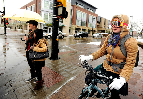 "University of Colorado student Sophia Cortopassi, right, Maika Nagasawa and Shoki Ota, left, wait for the crosswalk at the intersection of Broadway and Canyon Boulevard on Tuesday, April 3, in Boulder. For more photos and video of the snow storm go to  <a href=""http://www.dailycamera.com"">http://www.dailycamera.com</a><br />  Jeremy Papasso/ Camera"