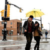 "Shoki Ota, left, and Maika Nagasawa use an umbrella to stay dry from the wet snow while using the crosswalk near the intersection of Broadway and Walnut Streets on Tuesday, April 3, in Boulder. For more photos and video of the snow storm go to  <a href=""http://www.dailycamera.com"">http://www.dailycamera.com</a><br />  Jeremy Papasso/ Camera"