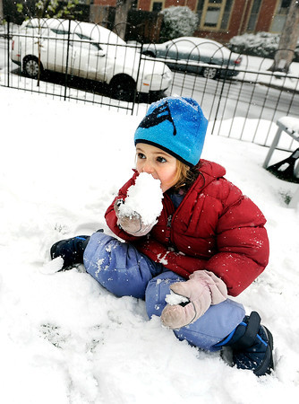 "Rachel Tilton, 4, takes a bite out of a snow ball while playing in the snow on Tuesday, April 3, on Mountain View Road in Boulder. For more photos and video of the snow storm go to  <a href=""http://www.dailycamera.com"">http://www.dailycamera.com</a><br />  Jeremy Papasso/ Camera"