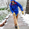 Tony Robleno works to clear a snowy sidewalk in Boulder  on Tuesday April 3, 2012.<br /> <br /> Photo by Paul Aiken / The Camera