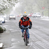 Per Gullberg finishes up his slushy bike commute from Niwot as he nears downtown Boulder for work on Tuesday April 3, 2012.<br /> <br /> Photo by Paul Aiken / The Camera
