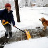 Juliana Forbes get help from Sun E. Jim in clearing her walk of snow on Thursday morning. <br /> Photo by Paul Aiken The Camera