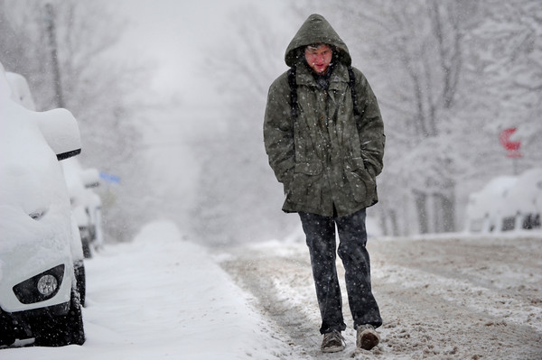 Kyle Bickel walks through falling snow on University HIll in Boulder as he heads to class on Thursday morning. <br /> Photo by Paul Aiken The Camera