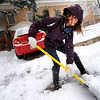Katherine Karubus works to clear a path out her driveway on University HIll in Boulder as she heads to work on Thursday morning. <br /> Photo by Paul Aiken The Camera