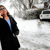 Juciene Wilk makes a phone call as her car sits stuck in some bushes.  Wilk said a car stopped in front of her as she came 9th Street. She drove off the road and sheared off a fire hydrant to avoid hitting the vehicle in front of her.<br /> Photo by Paul Aiken The Camera