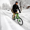Bryan Bolen rides his bike down a street on University HIll in Boulder as he heads to class on Thursday morning. <br /> Photo by Paul Aiken The Camera