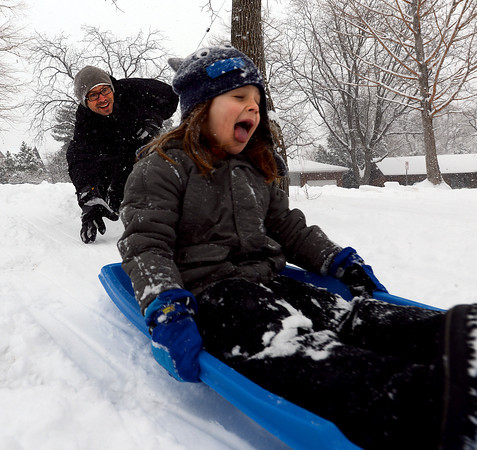 """Jim Risner gives his son, Kingston, 5, a push at North Boulder Park on Sunday. <br /> For more photos and a video of the current storm, go to  <a href=""""http://www.dailycamera.com"""">http://www.dailycamera.com</a>. <br />  Cliff Grassmick  / February 24, 2013"""