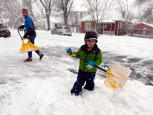 "Judge Greenhaw, 3, helps his dad, Brandon, remove the snow around their home on 9th Street in Boulder on Sunday.  <br /> For more photos and a video of the current storm, go to  <a href=""http://www.dailycamera.com"">http://www.dailycamera.com</a>. <br />  Cliff Grassmick  / February 24, 2013"