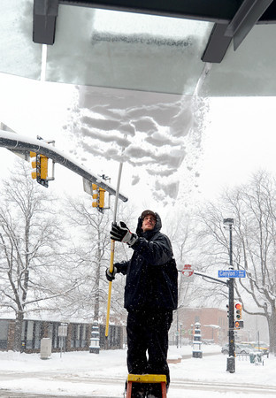 "Stephen Hacker removes  snow from the awning at the UBS building off of Canyon Blvd. on Sunday.<br />  For more photos and a video of the current storm, go to  <a href=""http://www.dailycamera.com"">http://www.dailycamera.com</a>. <br />  Cliff Grassmick  / February 24, 2013"