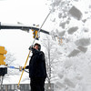 "Stephen Hacker removes  snow from the awning at the UBS building off of Canyon Blvd. on Sunday. <br /> For more photos and a video of the current storm, go to  <a href=""http://www.dailycamera.com"">http://www.dailycamera.com</a>. <br />  Cliff Grassmick  / February 24, 2013"
