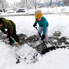Shane, 9 and his sister Zoe Cominsky, 12, shovel off their Boulder Colorado sidewalk after a winter snowstorm.<br /> Photo by Paul Aiken / The Camera / February 3, 2012
