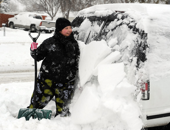 """Mary Pascua works hard to remove snow around her family's vehicle in Longmont on Friday.<br /> For more photos of the snow, go to  <a href=""""http://www.dailycamera.com"""">http://www.dailycamera.com</a>.<br /> February 3, 2012 / Cliff Grassmick"""