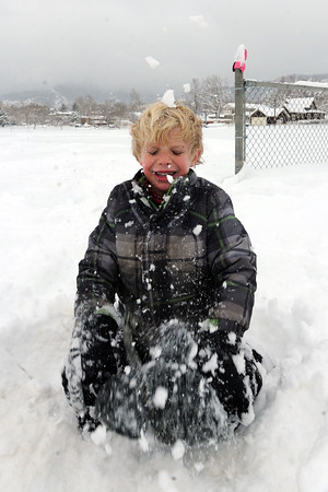 "Jonah Hutchin, 5, has fun in the snow at North Boulder Park on Friday.<br /> For a video of the snow, go to  <a href=""http://www.dailycamera.com"">http://www.dailycamera.com</a>.<br /> Cliff Grassmick / February 3, 2012"