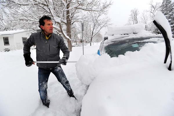 E.J. Meade clears off his wife's car in Boulder, Colorado  after a winter snowstorm.<br /> Photo by Paul Aiken / The Camera / February 3, 2012