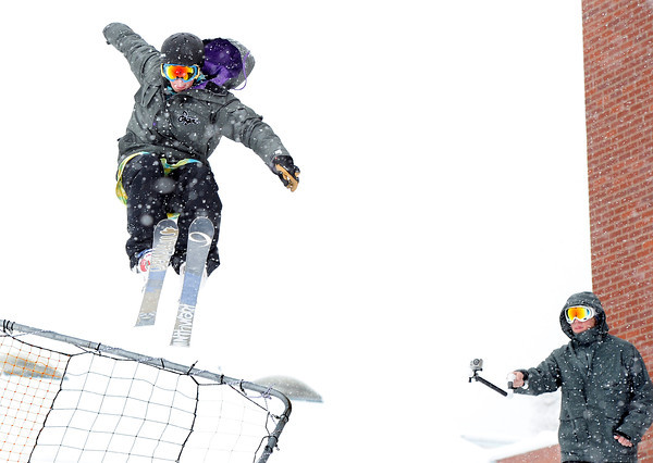 """Evan Cunningham, 20, of Boulder, left, catches some air from a jump while his friend Boomer Beatty, 19, of Boulder, films him on Friday, Feb. 3, at New Vista High School in Boulder. For a video of the rail jam go to  <a href=""""http://www.dailycamera.com"""">http://www.dailycamera.com</a><br /> Jeremy Papasso/ Camera"""