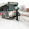 First Transit employees work on getting an RTD bus unstuck along Midway Blvd. near Garden Center in Broomfield during the February 3rd snowstorm.<br /> February 3, 2012<br /> staff photo/ David R. Jennings
