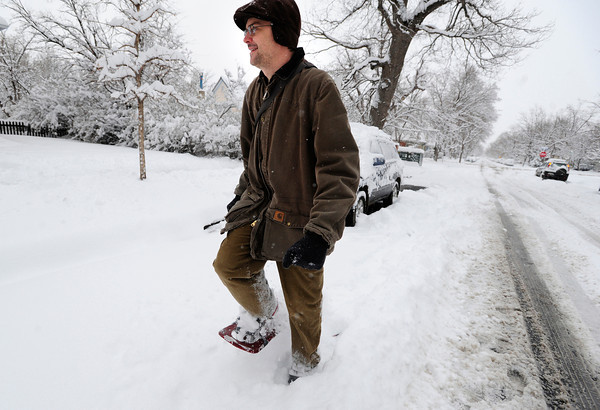 Charles Lerose snowshoes down a snowy street in Boulder, Colorado  after a winter snowstorm.<br /> Photo by Paul Aiken / The Camera / February 3, 2012